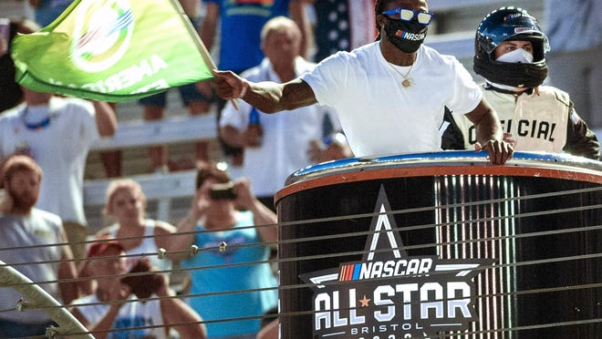 Former University of Tennessee and current New Orleans Saints running back Alvin Kamara waves the green flag to start the NASCAR All Star race Wednesday night at Bristol (Tennessee) Motor Speedway.