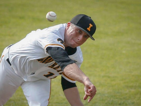 Iowa starting pitcher Cole McDonald fires a pitch against