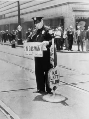 Los Angeles police officer Raymond Woody read about the D-Day invasion while directing traffic.   June 6, 1944.