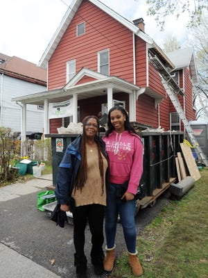 Myrtle DeFairia and her daughter, Diamond, stand at their City of Poughkeepsie home, which was repaired by a crew from Rebuilding Together Dutchess County.