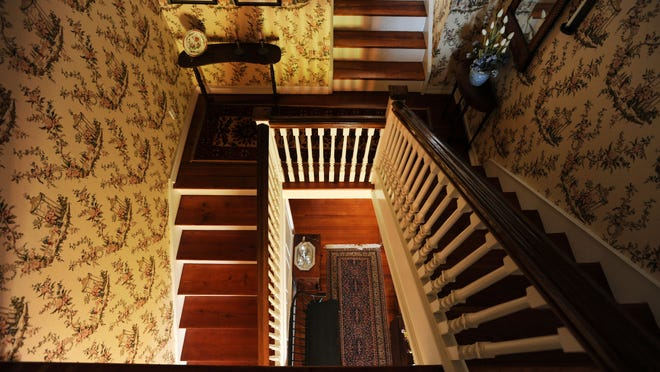 The staircase at Stratton Manor winds around to the second floor. The walls are covered with a reproduction of a vintage Dutch wallpaper design. The historic home is featured on this year's Eastern Shore House and Garden Tour.