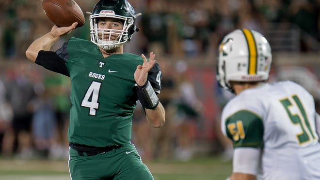 Trinity's Nick John drops back to pass during the game played against Saint Xavier at The University of Louisville's Papa John's Stadium in Louisville, Ky, Friday, September 29, 2017.  (Photo Bryan Woolston)