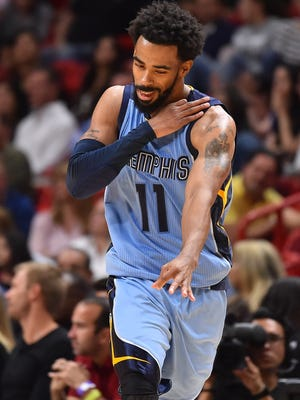 Memphis Grizzlies guard Mike Conley (11) gestures after making a three point basket against the Miami Heat during the second half at American Airlines Arena.