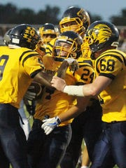 South Lyon players celebrate after Will Kelley (24)