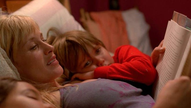 """This image released by IFC Films shows Patricia Arquette and Ellar Coltrane in a scene from the film, """"Boyhood."""""""