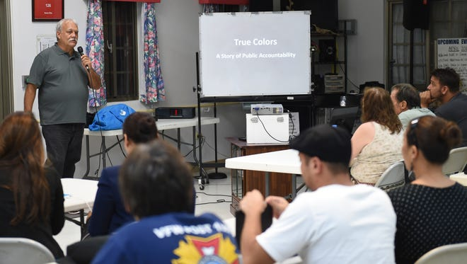 In this file photo, Ken Leon-Guerrero, spokesman for Citizens for Public Accountability, gives a presentation to members of the community about a planned referendum to repeal elected officials' pay raises.