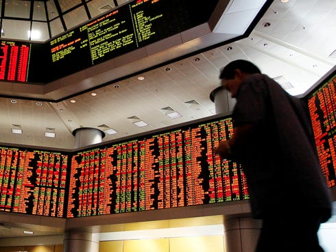 Share prices are displayed during afternoon trading at a private stock market gallery in Kuala Lumpur, Malaysia, on Nov. 4, 2013.