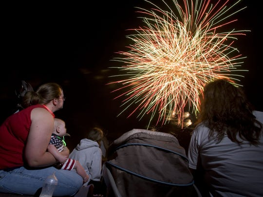 The W.H. Lyon Fairgrounds 2012 fireworks display in celebration of the Fourth of July.   Argus Leader file photo Heather Korbin, (in red) holds son Bryant, 7 months old, while at the WH Lyons Fairgrounds 2012 fireworks display in celebration of the fourth of July.   (Melissa Sue Gerrits / Argus Leader)