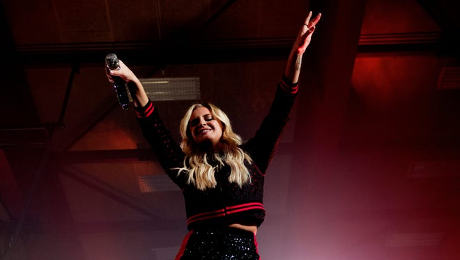 """Kelsea Ballerini performs at Central High School in Knoxville, Tennessee, on Saturday, October 28, 2017. Ballerini, of Knoxville, celebrated the release of her second album, """"Unapologetically,"""" at her old high school."""