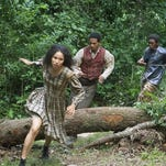 "Jurnee Smollett-Bell, from left, Alano Miller and Renwick Scott appear in a scene from ""Underground."" The series was filmed in several locations in southeastern Louisiana."