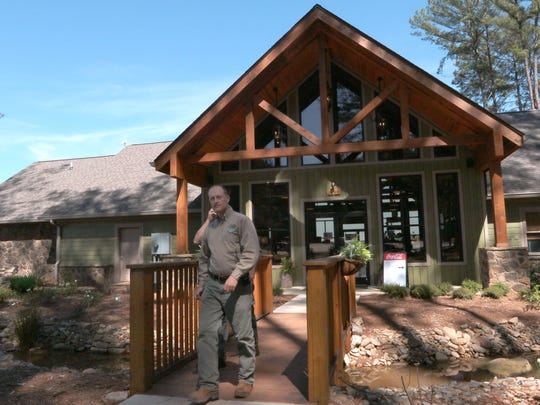 Stephen Schutt, park superintendent at South Cove County Park in Seneca, walks out of the park office of South Cove County Park in Seneca on Tuesday. The new office, built in 2016 for $275,000, is one of many improvements which helps make the campsite popular in South Carolina.