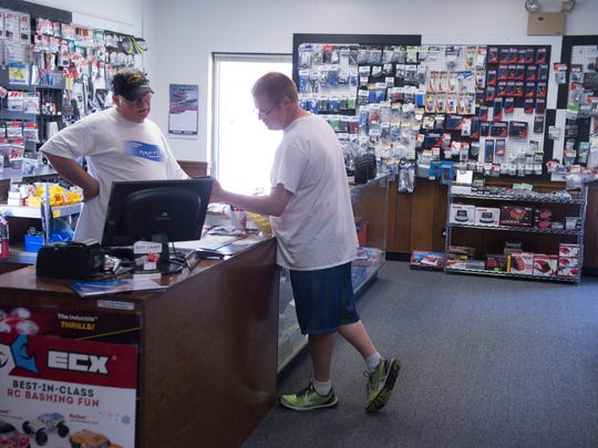Ray Young, left, owner of Henderson Hobbies, helps answer questions for customer Adam Stewart of Boonville, Ind., at the shop Wednesday afternoon.