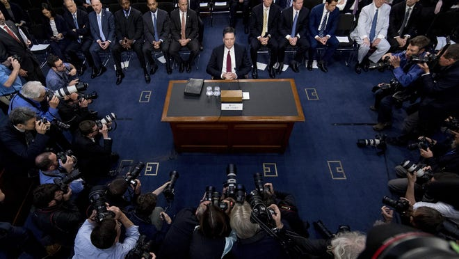 Former FBI Director James Comey arrives Thursday for a Senate Intelligence Committee hearing on Capitol Hill.
