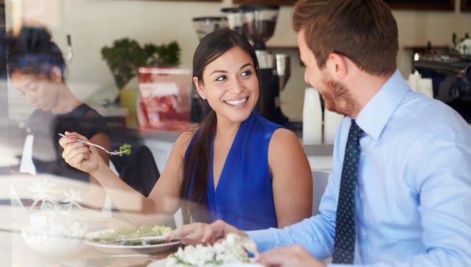 Woman and man eating lunch