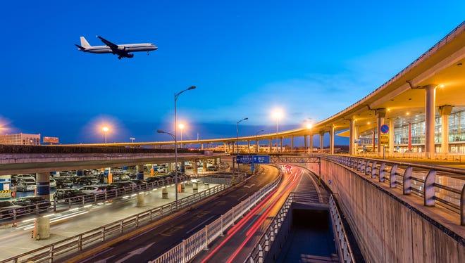 A plane lands at Beijing Capital International Airport.