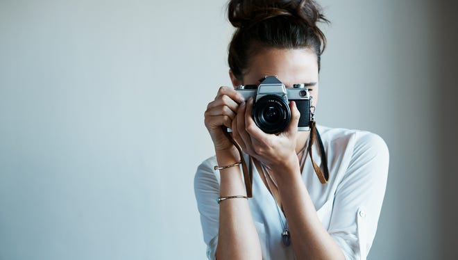 Cropped shot of a young woman taking a photo with a vintage camerahttp://195.154.178.81/DATA/i_collage/pu/shoots/805862.jpg