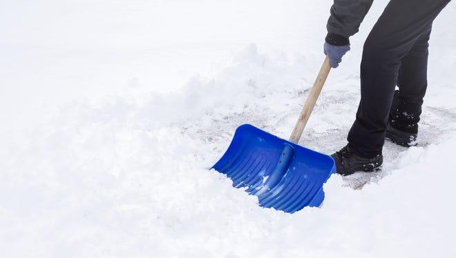 Tips to avoid back strain when shoveling snow.