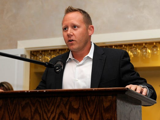 RCD Sales partner Ryan Haire accepts the Business of the Year Award during the Licking County Chamber of Commerce's 11th Annual Dinner and Awards Celebration on Tuesday, Aug. 12, 2014, at Moundbuilders Country Club.