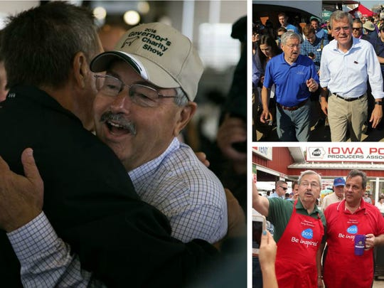 On the left, Gov. Terry Branstad embraces John Kasich.