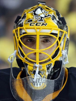Pittsburgh Penguins goalie Marc-Andre Fleury (29) looks on against the Columbus Blue Jackets during the third period.