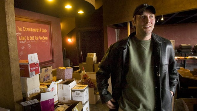 Shawn Petersen, owner of Corks Grill & Wine Bar, looks over the new location in Sartell in December 2007. His was among the noteworthy independent restaurants in the St. Cloud area in the past 10 years.