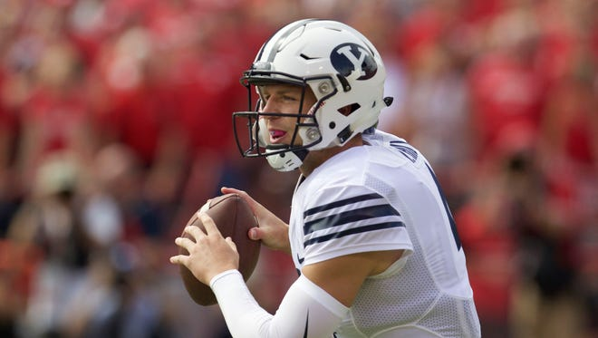 Brigham Young Cougars quarterback Taysom Hill (4) looks to pass against the Nebraska Cornhuskers in the first half at Memorial Stadium.