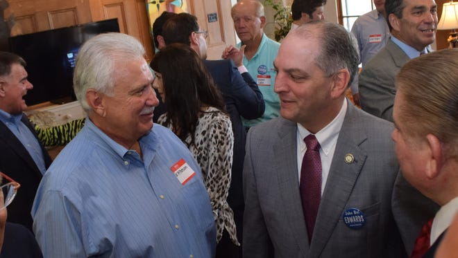 Joe McPherson (left), a former state senator, talks with Democratic gubernatorial candidate John Bel Edwards on Thursday at a fundraiser at the home of Sen.-elect Jay Luneau, who is McPherson's cousin.
