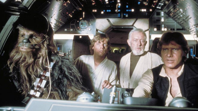Peter Mayhew as Chewbacca, Mark Hamill as Luke Skywalker, Sir Alec Guinness as Obi-Wan Kenobi and Harrison Ford as Han Solo in a scene from the motion picture Star Wars Episode IV - A New Hope.