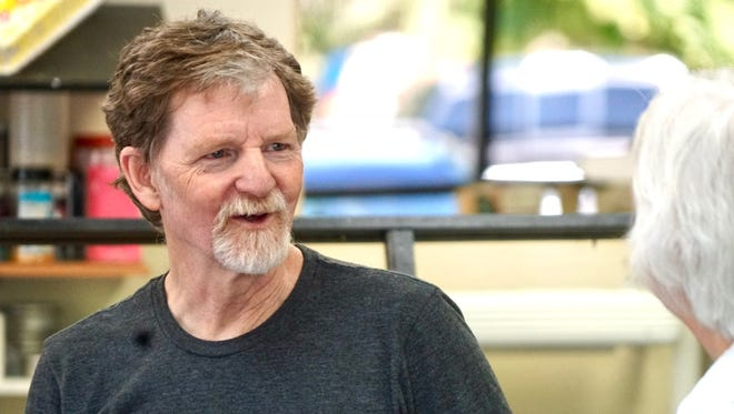 Masterpiece Cakeshop owner Jack Phillips talks with a customer following the Supreme Court ruling.