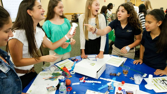 Nyah Castellon, 14, far left, Briana Hein, 14, Thai West, 13, Raya Johnson, 13, Rebecca Elia, 13, and Mary Castillo, 14, were among 140 local students taking part in the Girls Going Places Entrepreneurship Conference at FGCU on Wednesday. Students learned about financial literacy and how to market products and start businesses.