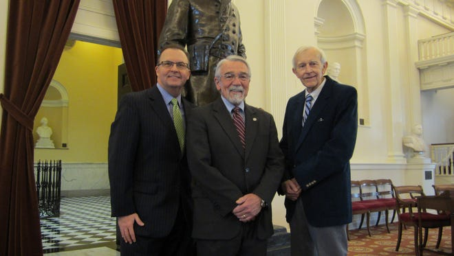 Paul Hatcher, right and Mike Stevens, left, with Del. Dicke Bell, R-Staunton, at the Virginia Capitol in Richmond on Tuesday after Hatcher and Stevens were named to the class of 2015 for the Virginia Sports Hall of Fame and Museum.