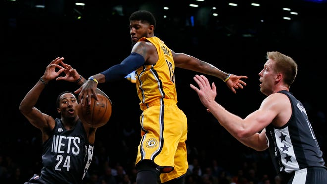 Oct 28, 2016; Brooklyn, NY, USA;  Indiana Pacers forward Paul George (13) battles for a rebound with Brooklyn Nets guard Rondae Hollis-Jefferson (24) and forward Justin Hamilton (41) during first half at Barclays Center.
