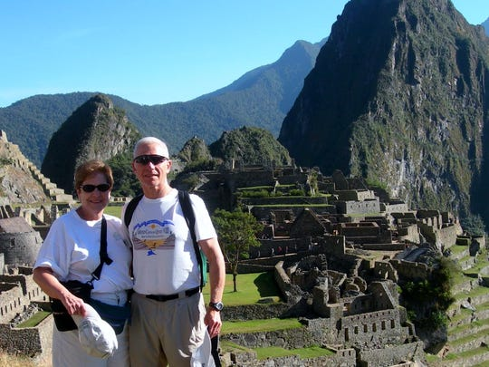 Walt Pheney and his wife, Phyllis, pose for a picture at Machu Picchu in the Peruvian Andes.
