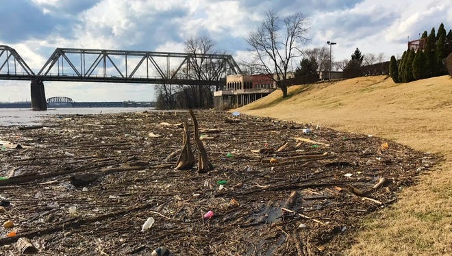 High water on the Ohio River flushed a lot of drift wood and litter to a bank near Louisville on Feb. 20, 2018.