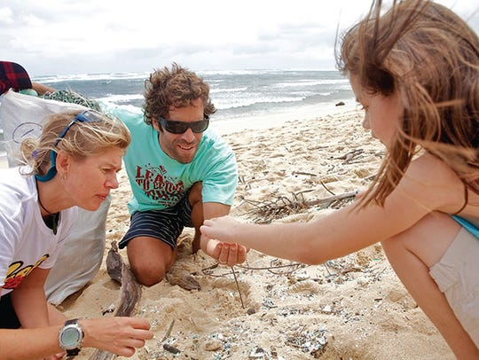 Hawaii resident Jack Johnson examines nurdles, which