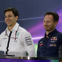 From left, Ferrari team principal Maurizio Arrivabene, flanked by Mercedes team principal Toto Wolff and Red Bull team principal Christian Horner attend a news conference at the Yas Marina racetrack in Abu Dhabi.