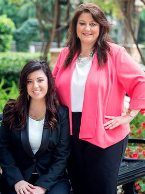 Beth Rose, right, and daughter Sara Rose Bytnar won first and second place respectively in the National Auctioneers Association 29th International Auctioneer Championships.