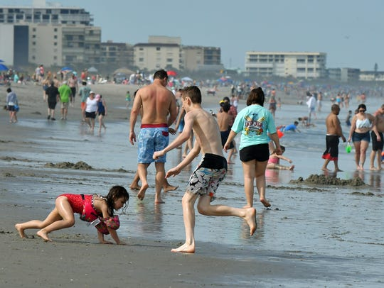 Beachgoers filled Cocoa Beach on Monday afternoon,