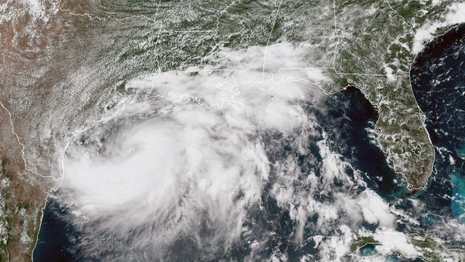 A weather satellite photo shows Tropical Storm Hanna approaching the Texas Gulf Coast about 2 p.m. Friday.