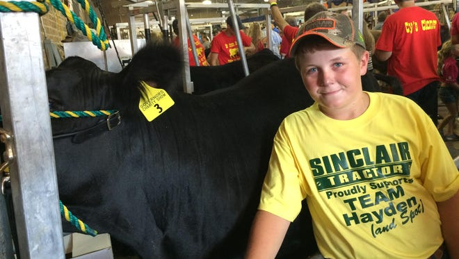 Hayden Watson, 11, showed his steer Spot in the Governor's Charity Steer Show Saturday at the Iowa State Fair.