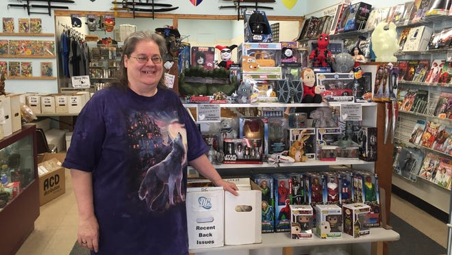 Tawna Lewis has worked at Fat Cat Comics almost from the first day, and she has owned the store since 2010.