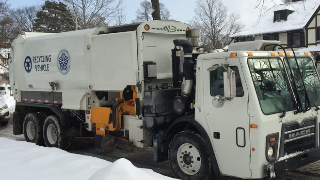 City of Rochester recycling collection truck. The newly purchased vehicle picks up and empties large recycables toters.
