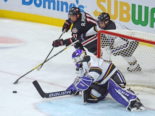 St. Cloud State's Ryan Poehling (11) tries to get to