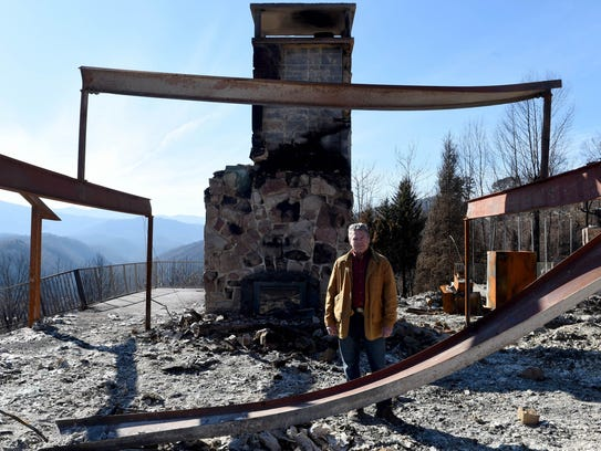 Gatlinburg Mayor Mike Werner stands among the ruins