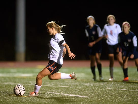 Northeastern's Amanda Bentz lines up a penalty kick