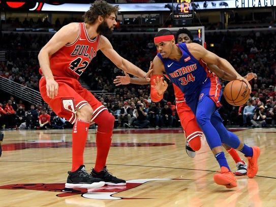 Pistons forward Tobias Harris (34) is defended by Bulls