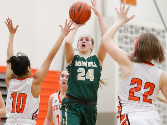 Howell's Leah Weslock shoots while Northville defenders