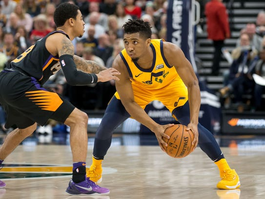 Utah Jazz guard Donovan Mitchell controls the ball