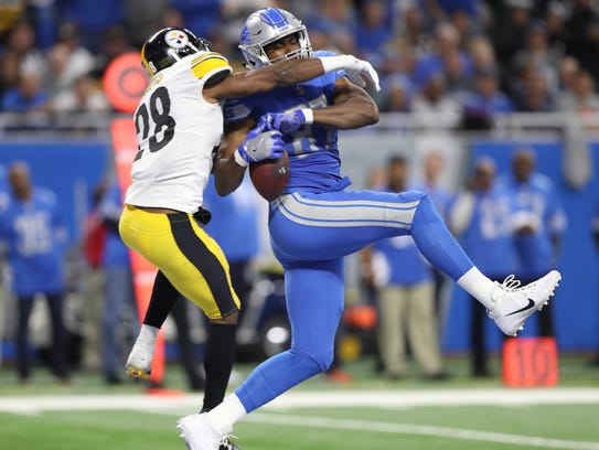Lions tight ends Darren Fells is defended by Steelers