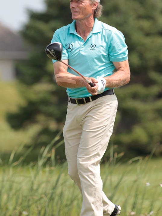Bernhard Langer, of Germany, hits his drive off the first tee during the first round of the 3M Championship golf tournament at the TPC Twin Cities in Blaine, Minn. Friday, Aug 1, 2014. AP Photo/Paul Battaglia)